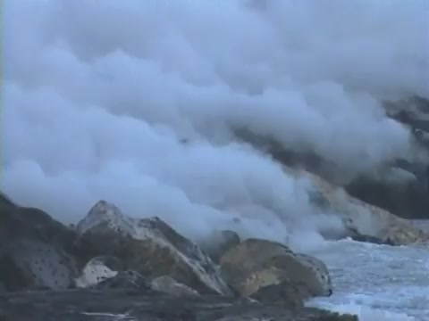 Scenics of lava flowing into ocean