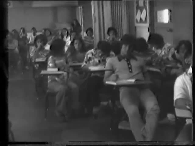 Emmett and George talk to juniors at Kamehameha Schools circa 1977