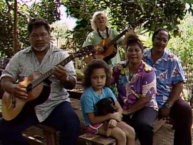 """Roland """"Lale"""" Kaʻalekahi, Anna Goodhue, and ʻohana sing """"Molokaʻi Nui a Hina"""" 1989"""