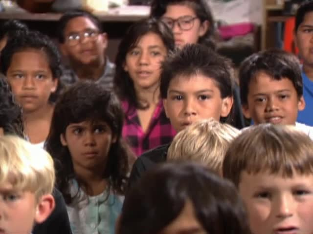 "Students at Mountain View Elementary School sing ""Nānā Mai"" with director Eddie Kamae"