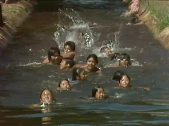 Reenactment of the Three-Year Swim Club swimming in Puʻunēnē ditch 8/83